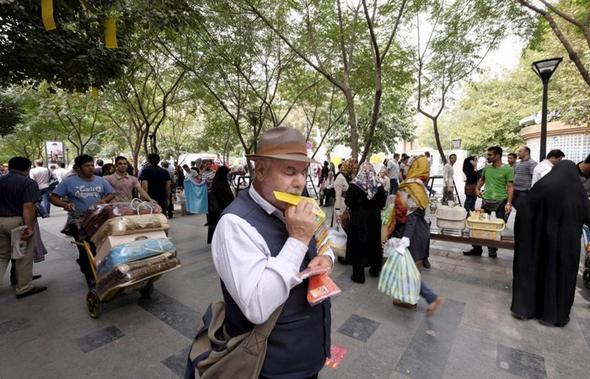 تصاویر : گزارش رویترز از بازار تهران