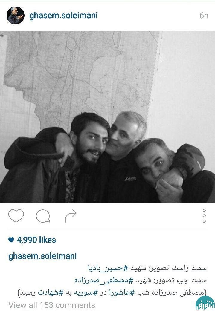 سردارسلیمانی در کنار دو شهید حرم+ عکس