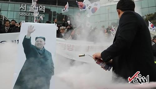 معترضان تصویر رهبر و پرچم کره شمالی را در سئول آتش زدند