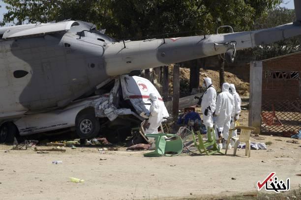 تصاویر : سقوط مرگبار بالگرد حامل وزیر کشور مکزیک روی دو خودرو