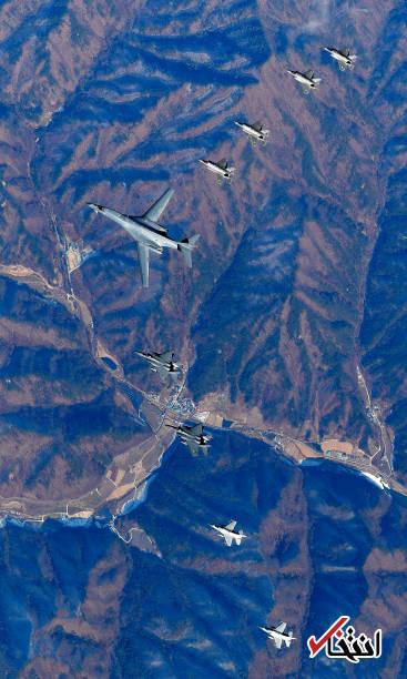 عکس/ پرواز بمب افکن و جنگندههای آمریکا بر فراز شبه جزیره کره