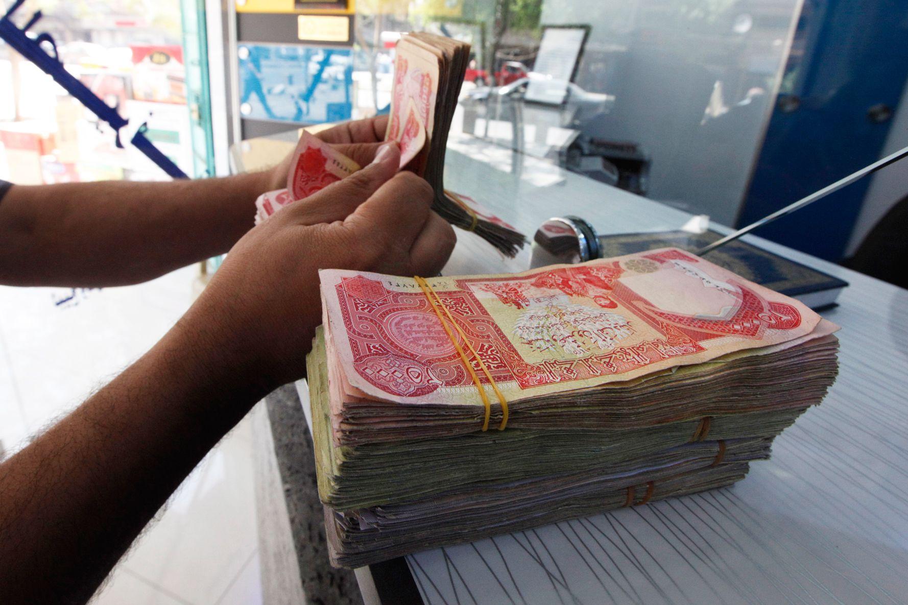 آیا مزایده فروش ارز در عراق، اقتصاد ایران را احیا میکند؟ / آیا تهران به دنبال افزایش ارزش ارز داخلی عراق است؟